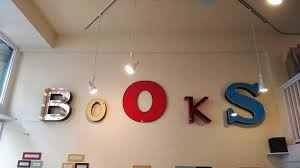 Books sign in Lucys